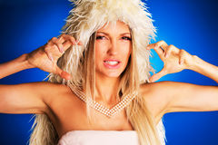 Luxurious angry woman. On blue background royalty free stock photos