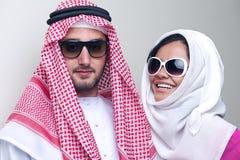 Luxurious arabian couple posing Royalty Free Stock Photography