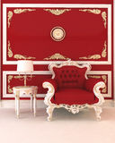 Luxurious armchair in royal red interior Royalty Free Stock Photography