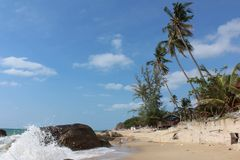 Paradise landscape with the Pacific Ocean, waves crashing against the stones, the beach and palm trees. Thailand Samui stock photo