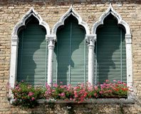 Luxurious balcony in Venetian style with arched windows Stock Image