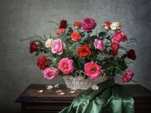 Luxurious basket with garden summer roses. Summer floral still life with luxurious bouquet of cut roses - beautiful wall poster royalty free stock photo