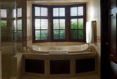 Luxurious Bath with window view Stock Photo