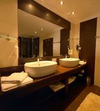 Luxurious bathroom. Close up of two hand wash basins in luxurious bathroom under mirror Stock Photo