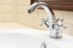 Luxurious Bathroom close-up - sink, faucet, tile Stock Photos