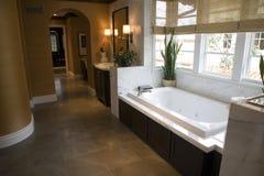 Luxurious bathroom with a modern tub. Designer bathroom with a modern tub and tile floor Royalty Free Stock Photo