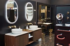 Luxurious bathroom in store. Luxurious washbasin toilet shower and mirror in the bathroom in store Stock Photos