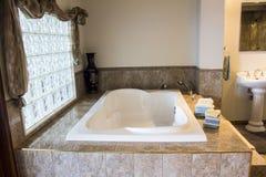 Luxurious bathtub. Bathroom sink relaxation image Stock Photos