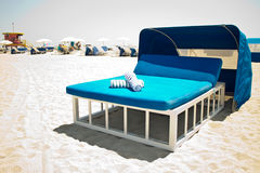 Luxurious beach bed with canopy on a sandy beach. A luxurious beach bed with canopy on a sandy beach Royalty Free Stock Photo