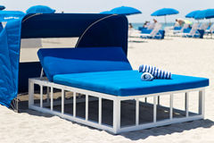 Luxurious beach bed with canopy on a sandy beach Stock Photos