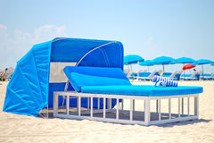 Luxurious beach bed with canopy on a sandy beach Royalty Free Stock Images