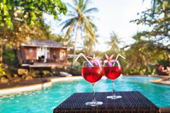 Luxurious beach hotel, luxury holidays, two cocktails. Luxurious beach hotel, two cocktails near swimming pool, luxury lifestyle royalty free stock photography