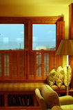Luxurious beach house. Interior details of living room in luxurious beach house by ocean, sea, visible through windows Stock Photography