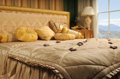Luxurious bed. In a number with a kind on mountains Stock Photo