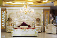 Luxurious bed in classic style Stock Photos