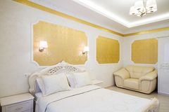 Luxurious bed with cushion in royal bedroom interior Royalty Free Stock Photography
