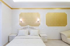 Luxurious bed with cushion in royal bedroom interior Stock Photo
