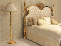 Luxurious bed with golden frame and stand Stock Photos