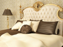 Luxurious bed with pillows in royal interior Royalty Free Stock Photo