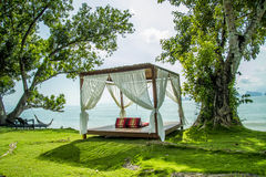 Luxurious bed by the sea, the beach to relax Royalty Free Stock Photo