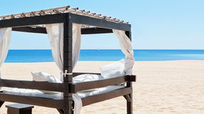 Luxurious bed by the sea, the beach to relax on vacation. Stock Images