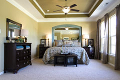 A luxurious bedroom. A staged luxurious bedroom interior Royalty Free Stock Photos