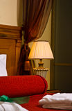 Luxurious bedroom. Details of luxurious antique furniture in bedroom royalty free stock image
