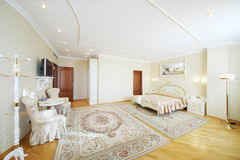 Luxurious bedroom with beautiful double bed, with armchairs Stock Photo