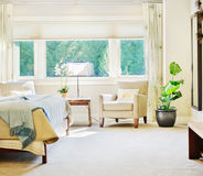 Luxurious Bedroom Detail. Bedroom in luxury home with outdoor view royalty free stock photo