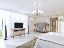 Luxurious bedroom with a large sofa and TV unit the large window Royalty Free Stock Image