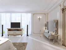 Luxurious bedroom with a large sofa and TV unit the large window Stock Image