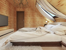 Luxurious bedroom in modern style, with a roof window in the log Royalty Free Stock Images