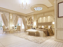 Luxurious bedroom in pastel colours in a neoclassical style. Luxurious bedroom in pastel colours in a neoclassical style, with a large bed and a dressing table Royalty Free Stock Photo
