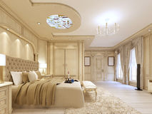 Luxurious bedroom in pastel colours in a neoclassical style. Stock Photos