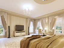 Luxurious bedroom in pastel colours in a neoclassical style. Luxurious bedroom in pastel colours in a neoclassical style, with a large bed and a dressing table Stock Image