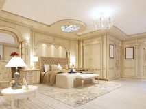 Luxurious bedroom in pastel colours in a neoclassical style. Luxurious bedroom in pastel colours in a neoclassical style, with a large bed and a dressing table Stock Photo