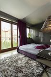 Luxurious bedroom with terrace window Royalty Free Stock Photography