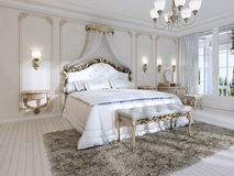 Luxurious bedroom in white colors in a classic style. Royalty Free Stock Photography