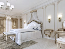 Luxurious bedroom in white colors in a classic style. Royalty Free Stock Photo