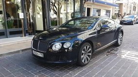 Luxurious Bentley Continental Car In Monaco. Monte-Carlo, Monaco - January 25, 2019: Luxurious Bentley Continental Car Parked In Front Of The Hermitage Hotel stock video footage