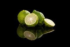 Luxurious bergamot background. Ripe bergamot fruit on black background. Culinary cooking ingredient, tropical fruit bergamot orange royalty free stock photography