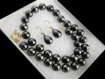 Luxurious black pearl necklace earrings jewelry set choker royalty free stock photography