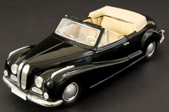Luxurious black retro classic car. Picture of a black beautifully restored classic car Stock Image