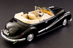 Luxurious black retro classic car. Picture of a black beautifully restored classic car Royalty Free Stock Photography