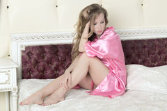 Luxurious blonde in a pink robe Stock Photo