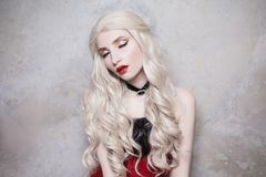 Luxurious blonde woman with beautiful long white hair royalty free stock images