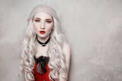 Luxurious blonde woman with beautiful long white hair royalty free stock photography
