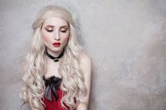 Luxurious blonde woman with beautiful long white hair stock images
