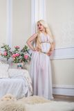Luxurious blonde woman in a white dress Royalty Free Stock Photography
