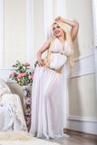 Luxurious blonde woman in a white dress Royalty Free Stock Photo